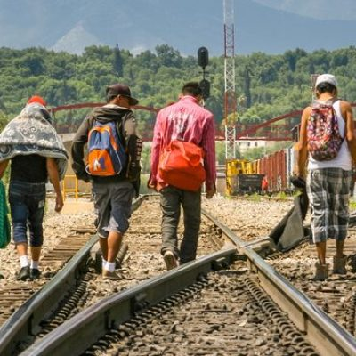 Coahuila, Mexico, Jun 16 - A group of migrants of Central American origin waits on the railway line to get on a container train, known as'The Beast', to go to the border of the United States and Mexico, between the states of Coahuila (Mexico) and Texas (USA).